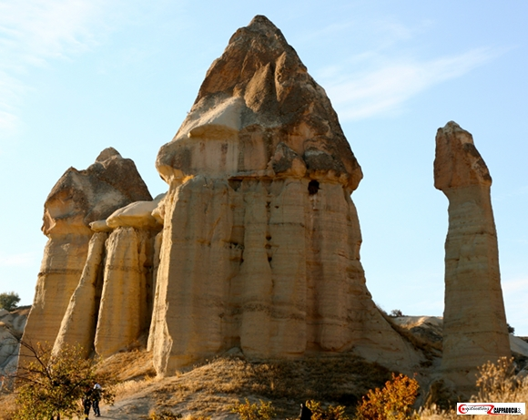 3 fairy chimneys in love valley under a blue sky