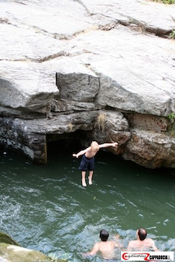 boy jumping in the river in Ihlara valley in Cappadocia