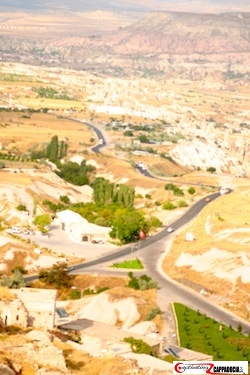 View of Cappadocia from uchhisar rock tower - the whole valley spreading out below with the road winding through it